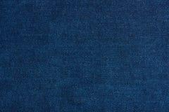 Donkerblauwe dichte omhooggaand van de jeanstextuur Stock Afbeelding