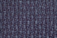 Donkerblauwe gebreide wollen achtergrond met een patroon van zachte, wolachtige doek Textuur van textielclose-up Royalty-vrije Stock Foto's