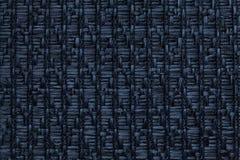 Donkerblauwe gebreide wollen achtergrond met een patroon van zachte, wolachtige doek Textuur van textielclose-up Stock Foto's