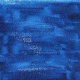 Donkerblauwe geschilderde achtergrond op canvas Royalty-vrije Stock Afbeeldingen