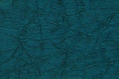 Donkerblauwe golvende achtergrond van een textielproduct Stof met de close-up van de vouwentextuur Royalty-vrije Stock Afbeelding