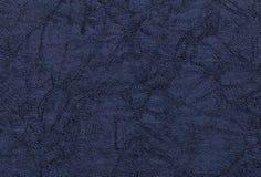 Donkerblauwe golvende achtergrond van een textielproduct Stof met natuurlijke textuurclose-up Stock Foto