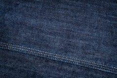 Donkerblauwe jeanstextuur Stock Foto