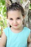 Donkerbruin meisje in leerjasje Stock Foto