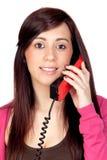 Donkerbruin meisje met een telefoon Stock Foto