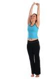 Donkerbruin sportmeisje stretchs omhoog Royalty-vrije Stock Fotografie