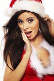 Donkerbruine vrouw die sexy cl van de Kerstman draagt Stock Foto's