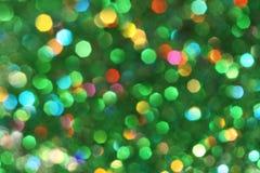 Donkere abstracte groen, rood, geel, turkoois schittert achtergrondkerstmis boom-samenvatting achtergrond Stock Afbeelding