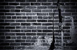 Donkere Bakstenen muur Stock Afbeelding