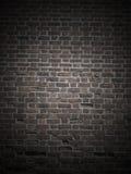 Donkere bakstenen muur stock fotografie