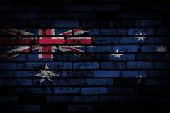 Donkere bakstenen muur backround of textuur met het mengen van de vlag van Australië Royalty-vrije Stock Afbeeldingen