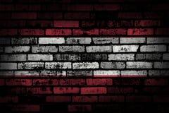Donkere bakstenen muur backround of textuur met het mengen van de vlag van Oostenrijk Royalty-vrije Stock Afbeelding