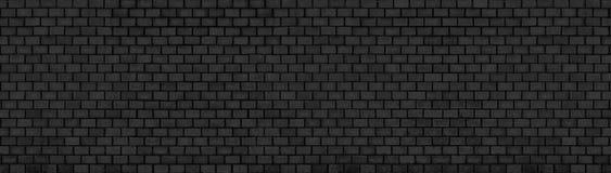 Donkere bakstenen muur, textuur van zwarte steenblokken, hoge resolutie Royalty-vrije Stock Afbeeldingen