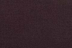 Donkere bruine achtergrond van een textielproduct met rieten patroon, close-up Stock Fotografie