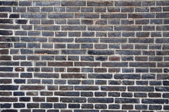 Donkere bruine bakstenen muur Stock Foto