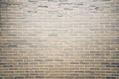 Donkere bruine de textuurachtergrond van de grungebakstenen muur Stock Afbeeldingen