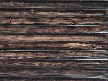 Donkere bruine houten planken stock foto