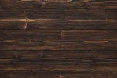 Donkere bruine houten textuur met natuurlijke gestreepte patroonachtergrond Stock Foto's