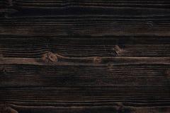 Donkere bruine houten textuur met natuurlijke gestreepte patroonachtergrond Stock Afbeelding