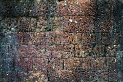 Donkere bruine laterite steenmuur Stock Fotografie