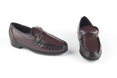 Donkere bruine schoenen Royalty-vrije Stock Afbeeldingen
