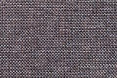 Donkere bruine textielclose-up als achtergrond Structuur van de stoffenmacro Royalty-vrije Stock Afbeelding