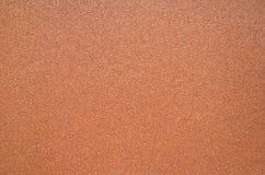 Donkere bruine textuur van ruw schuurpapier Stock Fotografie