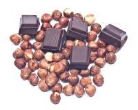 Donkere chocolade en hazelnoten Stock Foto's