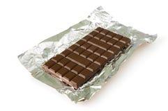 Donkere chocolade op een folie Stock Afbeelding