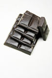Donkere chocolade op witte achtergrond Stock Afbeelding