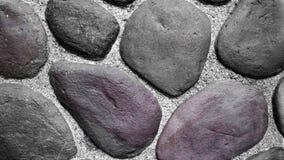 Donkere de textuurachtergrond van de steenmuur Stock Afbeeldingen