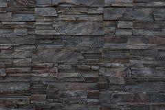 Donkere de textuurachtergrond van de steenmuur Stock Foto