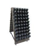 Donkere flessen op een houten die steun van de wijnkelder over wit wordt geïsoleerd Royalty-vrije Stock Foto's