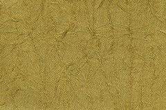 Donkere gele golvende achtergrond van een textielproduct Stof met de close-up van de vouwentextuur Royalty-vrije Stock Afbeelding