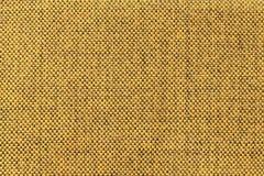 Donkere gele textielachtergrond met schaakpatroon, close-up Structuur van de stoffenmacro Royalty-vrije Stock Foto's