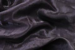 Donkere glanzende gevouwen textiel Stock Afbeeldingen