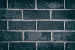 Donkere grijze dichte omhooggaande textuur van ruwe baksteentegels Stock Fotografie