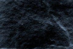 Donkere grijze zwarte die leiachtergrond of textuur, van echte echte steen van aard wordt gedetailleerd Stock Foto's