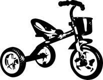 Donkere kinderen` s driewieler Stock Fotografie