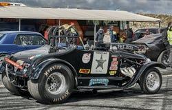 Donkere marineraceauto Stock Afbeeldingen