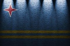Donkere muur vijf lichtenachtergrond met het mengen van de vlag van Aruba Stock Foto's
