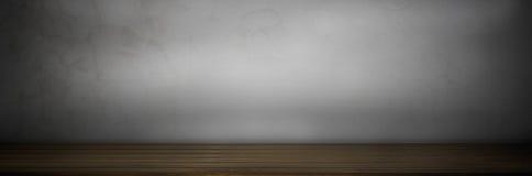 donkere oude grungbovenkant van de houten achtergrond van de lijstvloer op grijze muur Royalty-vrije Stock Foto