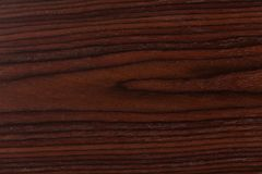 Donkere palisander achtergrond met natuurlijke patronen stock foto's