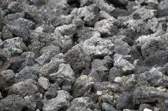 Donkere textuur van de gebrande stenen van steenkoolslakken Stock Foto's