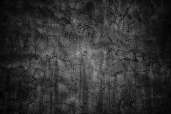 Donkere textuur van een cementmuur, zwarte stedelijke achtergrond Stock Foto