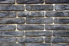 Donkere textuur van zwarte bakstenen op de muur van het gebouw Royalty-vrije Stock Afbeelding