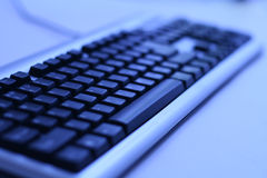 Donkere toetsenbordachtergrond Stock Foto