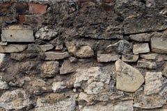 Donkere van de rotstextuur close-up als achtergrond Stock Afbeeldingen