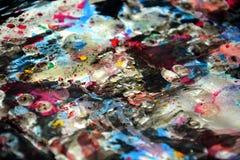 Donkere verf levendige wasachtige vage kleuren, contrasten, wasachtige creatieve achtergrond stock foto's