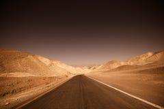 Donkere woestijnweg Royalty-vrije Stock Foto